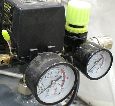 Plumbing from tank to discharge coupler on air compressor - https://www.about-air-compressors.com