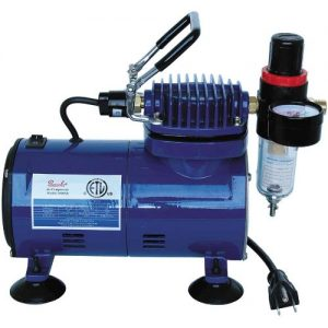 A Paasche D500 SR 1/8 HP air compressor.